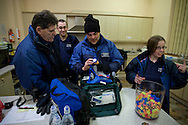 Members of the the Derby Street Pastor team checking and packing equipment at a local church hall before setting out for the night on patrol in Derby city centre. Street Pastor was pioneered in London in January 2003 and Derby Street Pastors is a partnership of 25 local churches, Derbyshire Police, local council and various groups concerned with city centre street business and safety. Each Street Pastor team member works a minimum of one night a month, usually from 10pm to around 4am.