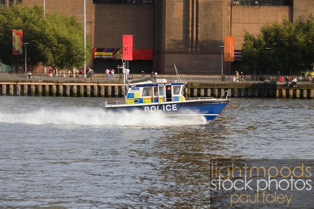 Police boat on Thames River, London, UK