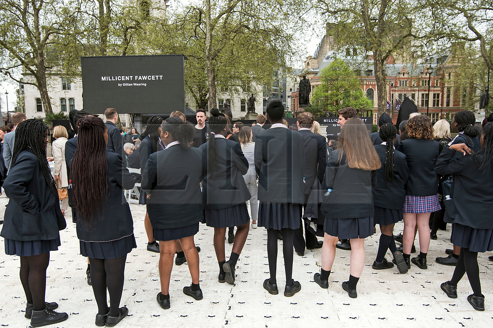 © Licensed to London News Pictures. 24/04/2018. London, UK. A group of schoolgirls attend the unveiling of a statue of Millicent Fawcett in Parliament Square, London. Dame Millicent, a leading Suffragist and campaigner for equal rights for women, is the first woman to be commemorated with a statue in Parliament Square. Photo credit: Ben Cawthra/LNP