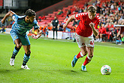Forest Green Rovers defender Dominic Bernard (3) and Charlton Athletic midfielder Alfie Doughty (45) during the EFL Cup match between Charlton Athletic and Forest Green Rovers at The Valley, London, England on 13 August 2019.