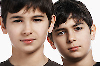 Twin boys (13-15) close-up portrait