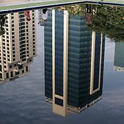 May 09, 2013 - Yangon, Myanmar: The reflexion of business buildings in a fountain at a public park in central Yangon. (Paulo Nunes dos Santos/Polaris)