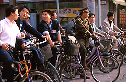 CHINA SHANGHAI MAY99 - Chinese men on bicycles stand in the traffic in downtown Shanghai. jre/Photo by Jiri Rezac