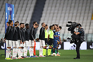 The two teams and officials line up before kickoffk off during the Serie A match at Allianz Stadium, Turin. Picture date: 26th June 2020. Picture credit should read: Jonathan Moscrop/Sportimage