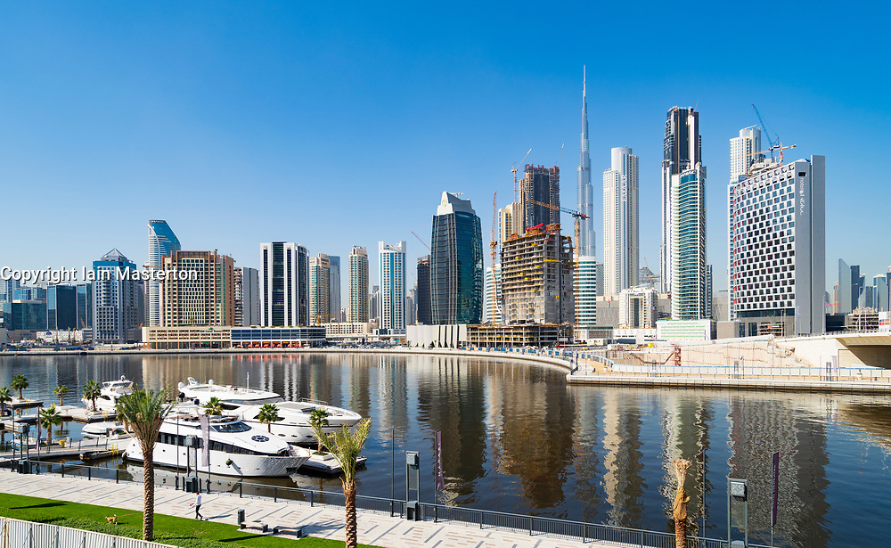 Daytime view of modern skyline of Business Bay and The Creek waterway  in Dubai, United Arab Emirates