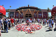 ANAHEIM, CA - JULY 12:  Fans line up outside the stadium while surrounding the memorabilia tribute to fallen Angel Nick Adenhart #34 of the Los Angeles Angels of Anaheim at the game against the New York Yankees at Angel Stadium on Sunday, July 12, 2009 in Anaheim, California.  The Angels defeated the Yankees 5-4 and swept the three game series.  (Photo by Paul Spinelli/MLB Photos via Getty Images)