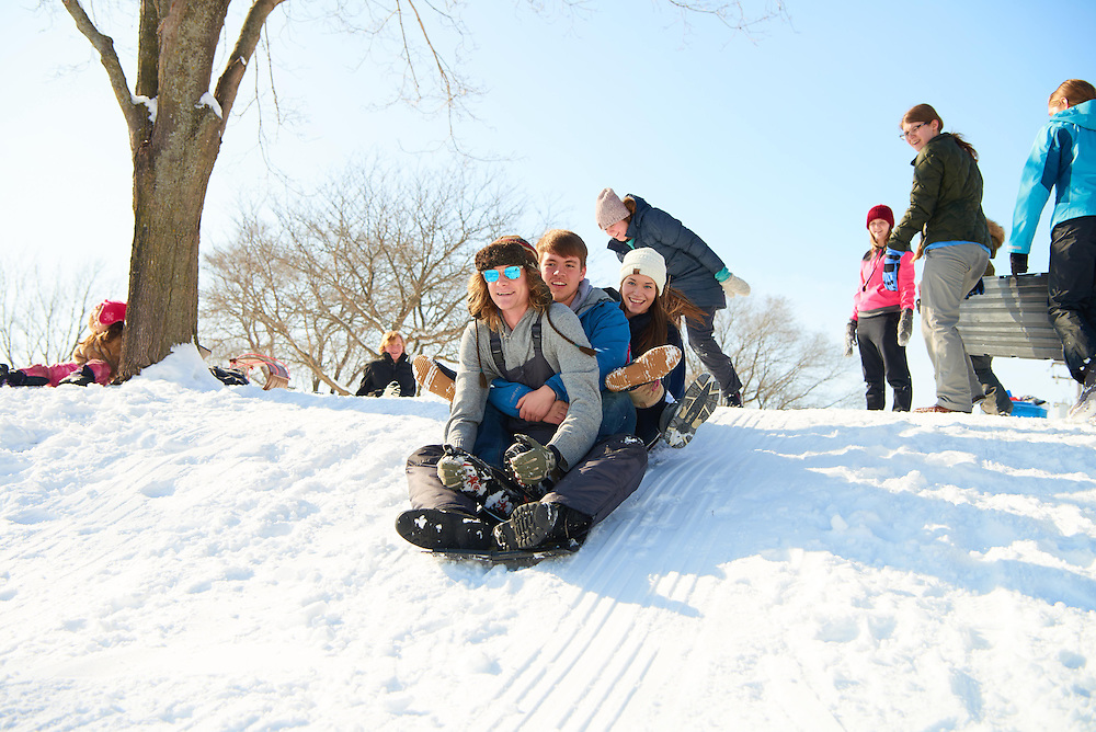 Activity; Sledding; Smiling; Socializing; Buildings; Bluffs; La Crosse; Trails; Location; Outside; Objects; People; Student Students; Man Men; Woman Women; Type of Photography; Candid; Winter; February; UWL UW-L UW-La Crosse University of Wisconsin-La Crosse; Lifestyle