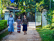 19 NOVEMBER 2017 - HWAMBI, YANGON REGION, MYANMAR: A nun walks into Sacred Heart's Catholic Church in Hwambi, about 90 minutes north of Yangon, before mass Sunday. Catholics in Myanmar are preparing for the visit of Pope Francis. He is coming to the Buddhist majority country November 27-30. There about 500,000 Catholics in Myanmar, about 1% of the population. Catholicism was originally brought to what is now Myanmar more than 500 years ago by Portuguese missionaries and traders.    PHOTO BY JACK KURTZ