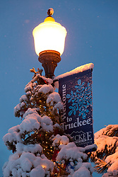 """Welcome to Snowy Truckee"" - This snow covered welcome sigh and Christmas tree were photographed in historic Downtown Truckee, CA."