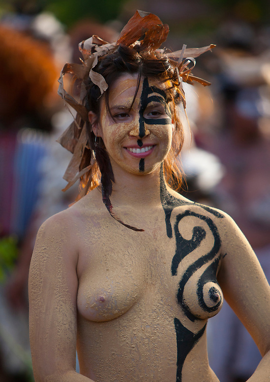 Body-painted woman during carnival parade of Tapati Festival in Hanga Roa, Easter Island, Chile. Tapati festival is a mix of carnival, sports, theatrical presentations and homage to Rapa Nui, it is celebrated annually in January and February; the sporting competitions are based on ancient sports, such as sliding down a cliff on a banana trunk in Haka Pei, swimming, oaring across Rano Raraku lake in a reed tortora raft and racing around the lake balancing heavy banana bunches over the shoulders; there are also dance competitions, parades with floats and costumed figures, that tourists are invited to join, and the crowning of the queen of the festival.