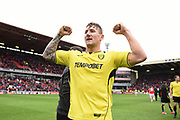 Burton Albion defender Kyle McFadzean (5) celebrates Burton Albion staying in the Championship in only their first season in the second tier during the EFL Sky Bet Championship match between Barnsley and Burton Albion at Oakwell, Barnsley, England on 29 April 2017. Photo by Richard Holmes.