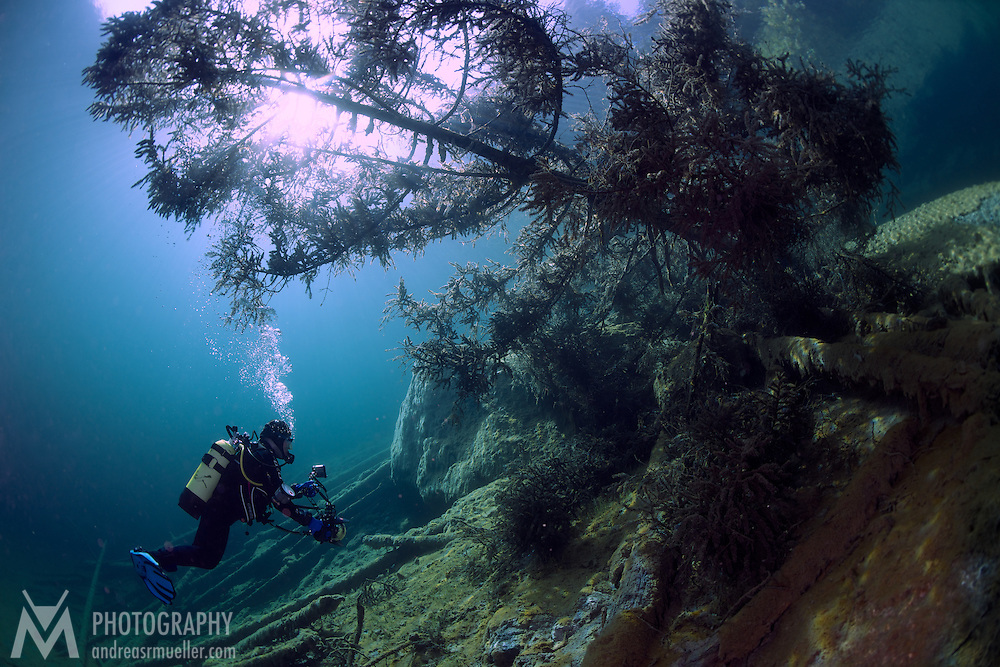 Fresh water scuba diving at Samarangersee, Austria. Incredible visibility, crystal clear water and mystic illumination. Spectacular underwater landscape.