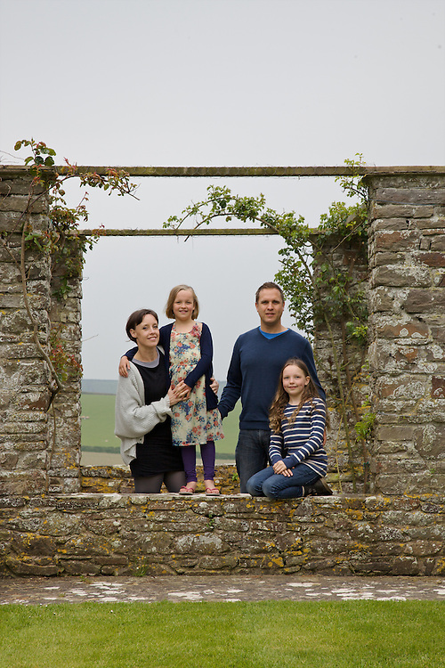 The Elliott family in the rose arbour at Pickwell Manor. From left to right: Tracey Elliott, Millie-grace Elliott (8), Richard Eliott, Molly Elliott (10). Pickwell Manor, Georgeham, North Devon, UK.<br /> CREDIT: Vanessa Berberian for The Wall Street Journal<br /> HOUSESHARE