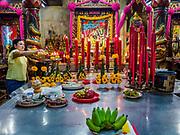 12 JULY 2018 - SAMUT PRAKAN, SAMUT PRAKAN, THAILAND: People pray and make merit in the Lak Mueang Shrine, about two blocks from the Talat Pak Nam, the main market in Samut Prakan, about 20 miles from central Bangkok.         PHOTO BY JACK KURTZ
