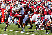 FAYETTEVILLE, AR - OCTOBER12:  Mike Davis #28 of the South Carolina Gamecocks runs up the middle for a touchdown against the Arkansas Razorbacks at Razorback Stadium on October 12, 2013 in Fayetteville, Arkansas.  The Gamecocks defeated the Razorbacks 52-7.  (Photo by Wesley Hitt/Getty Images) *** Local Caption *** Mike Davis
