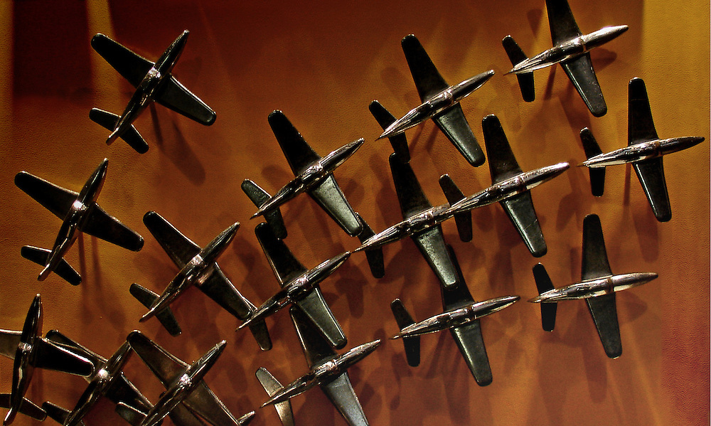 Rows of small metal planes casting a series of interesting overlapping shadows.