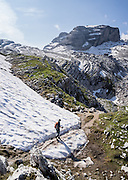 Hike across snow in Brenta Dolomites, near Rifugio Hutte Graffer. From the ski resort of Madonna di Campiglio in the Trentino-Alto Adige/Südtirol region of Italy, the Passo Groste lift takes you directly into the Brenta Dolomites to enjoy scenic mountain hiking trails. UNESCO honored the Dolomites as a natural World Heritage Site in 2009.
