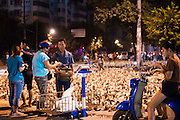 LIUZHOU, CHINA - AUGUST 27: (CHINA OUT) <br /> <br /> Selling Ducks On the street in China<br /> <br /> Residents pick ducks put on the street for sale on early morning of Zhongyuan Festival on August 27, 2015 in Liuzhou, Guangxi Province of China. Zhongyuan Festival, also known as Ghost Festival, Hungry Ghost Festival or Yu Lan Jie in Chinese, is a traditional Buddhist and Taoist festival held in Asian countries. In Chinese culture, the fifteenth day of the seventh month in the lunar calendar is called Ghost Day and the seventh month in general is regarded as the Ghost Month, in which ghosts and spirits, including those of the deceased ancestors, come out from the lower realm. While normally Guangxi people celebrate the festival on the fourteenth day and eating ducks is a traditional custom in local residents. <br /> ©Exclusivepix Media