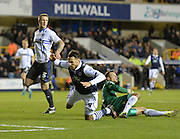 Millwall forward Lee Gregory is beaten to the ball by Bury goalkeeper Daniel Bachmann during the Sky Bet League 1 match between Millwall and Bury at The Den, London, England on 28 November 2015. Photo by David Charbit.