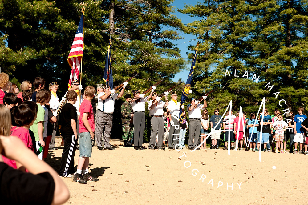 Laconia Middle School students observe a twenty-one-gun salute during a Memorial Day Observance on the shore of Lake Opechee on Friday, May 28, 2010.  (Alan MacRae/for the Citizen)