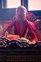 PARO, BHUTAN - CIRCA OCTOBER 2014: Bhutanese monk chanting and meditating during a ritual in Paro, Bhutan