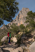 Hiking, Trekking at Southwest face of Puig Campana mountain in Costa Blanca, Finestrat, Alicante province,Spain, Europe