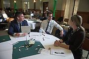 From left, Drake Sacenti, Joshua Staen and Annie Brackley attend the Darren Butler Sports Forum hosted by the Ohio University College of Business in Walter Rotunda on Friday, October 14, 2016.
