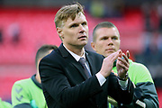Lithuania head coach Edgaras Jankauskas clapping hands during the FIFA World Cup Qualifier group stage match between England and Lithuania at Wembley Stadium, London, England on 26 March 2017. Photo by Matthew Redman.