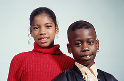 Portrait of young boy and teenage girl,