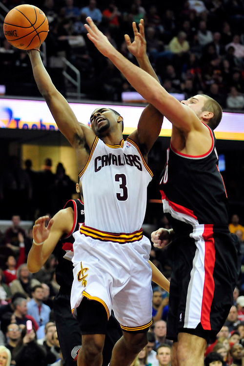 Feb. 5, 2011; Cleveland, OH, USA; Cleveland Cavaliers point guard Ramon Sessions (3) shoots over Portland Trail Blazers center Joel Przybilla (10) during the second quarter at Quicken Loans Arena. Mandatory Credit: Jason Miller-US PRESSWIRE