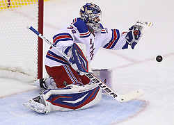 May 19, 2012; Newark, NJ, USA; New York Rangers goalie Henrik Lundqvist (30) makes a glove save during the first period in game three of the 2012 Eastern Conference Finals at the Prudential Center.