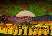 "PAEKTU, LAND OF NORTH KOREAN LEGENDS<br /> <br /> Mount Paektu volcano is considered a holy place for North Koreans. It is deemed the place of origin for them. The country's founding father Kim Il- Sung commanded anti-Japanese guerrilla in the 50's from a secret camp in this place.<br /> North Korea says his son Kim Jong-il was born there in 1942. He was actually born in Siberia, where his father had taken refuge from Japanese troops.<br /> The dear Leaders are said to have a ""mount Paektu bloodline ». A famous slogan says: « Let us all turn out in the general offensive to hasten final victory in the revolutionary spirit of Paektu! »<br /> A new probelm may erupt: when North Korea tests a nuclear weapon, specialists say the energy could trigger a volcanic...eruption in Paektu. That could be a huge disaster, killing thousands in North Korea and on the chinese side too.<br /> <br /> Photo shows:  Paektu is in all the mind of the north koreans as it is a myth for them. During Arirang show, it can be seen in the Kim Il Sung stadium with the sun rising up.<br /> ©Eric Lafforgue/Exclusivepix Media"