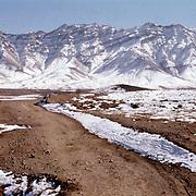 8 January 1963<br /> Kabul KK - 8 January: Kabul to Khord Kabul and Malik Khel. KK-1 - KK-19; 17 slides (2 missing) ; in 2nd drawer of 1st AAW slide box. Khord Kabul road, turnoff; LD X; Fabulous wall snowy mountains in background. ND