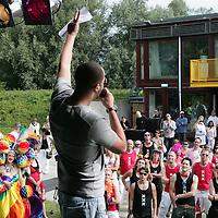 Nederland, Amsterdam , 1 augustus 2009..Moslims op barricade voor homo's..Kami-Kazi en Rachid Larouz treden op tijdens de openingsceremonie van de Gay Pride en Slotervaartjongens voetballen tegen homo's..Marcouch roept op: Oook hetero's en moslims moeten homo's helpen..Het gaat om de menswaardigheid..op 29 juli is in sportpark Sloten een voetbalwedstrijd tussen homo's en slotervaartjongens. Na de wedstrijd is er een halal babecue en een optreden van homo mannenkoor Manoeuvre..Op 1 augustus (zie foto) start de botenparade in slotervaart met een openingsceremonie..Cabaretier Rachid Larouz maakt sketches over het homobeleid en Kami-Kazi rapt over het homoverdriet in Nieuw West..Foto:Jean-Pierre Jans