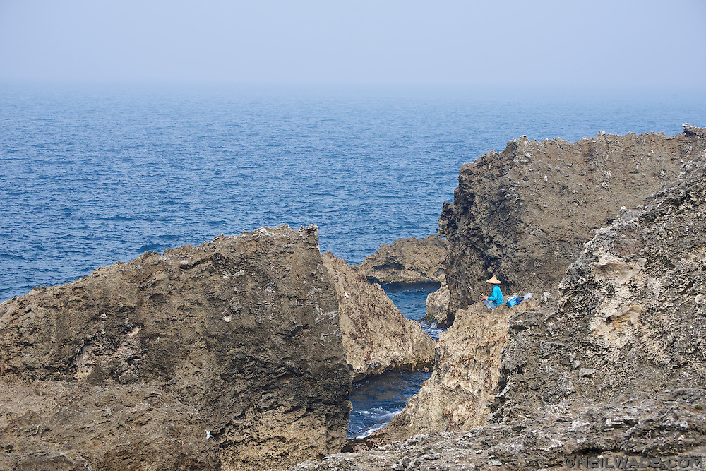 A fisherman fishes the abundant waters off the coast of Little Liuqiu, Tiaiwan.