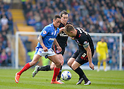 Portsmouth midfielder Kyle Bennett takes on Carlisle United Defender Danny Grainger during the Sky Bet League 2 match between Portsmouth and Carlisle United at Fratton Park, Portsmouth, England on 2 April 2016. Photo by Adam Rivers.