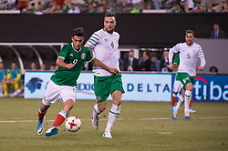 June 1, 2017 - East Rutherford, New Jersey, U.S - Mexico  forward RAòL JIMÆ'NEZ (9) dribbles the ball for a shot past Republic of Ireland defender SHANE DUFFY (4) during an international friendly match at Met Life Stadium in East Rutherford, NJ Mexico defeats Republic of Ireland 3 to 1. (Credit Image: © Mark Smith via ZUMA Wire)