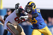 Dec 30, 2018; Los Angeles, CA, USA; Los Angeles Rams defensive end Aaron Donald (99) battles with San Francisco 49ers offensive guard Mike Person (68)at Los Angeles Memorial Coliseum. The Rams defeated the 49ers 48-31.  (Robin Alam/Image of Sport)