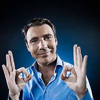caucasian man ok sign agreement portrait isolated studio on black background