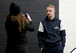 Celtic's Leigh Griffiths poses for a photograph at the side of the pitch as the men and women Street Soccer teams take part in a special training session at Lennoxtown, Glasgow.