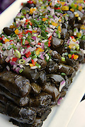 Close-up of Sarma (also warak enab or Dolma)- vine leaves wrapped around a filling of rice and minced meat