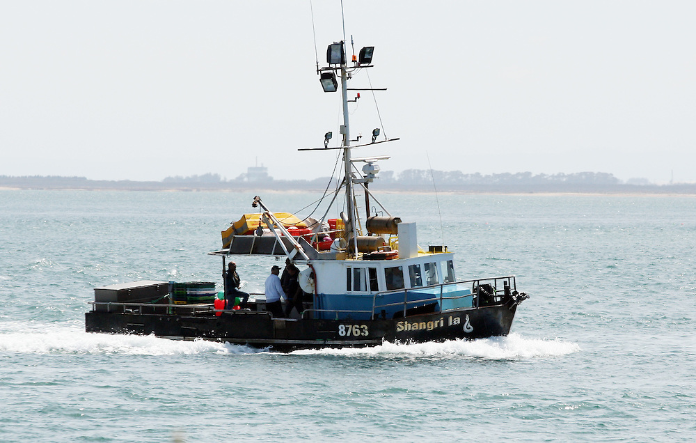 A fishing boat heads out to sea, Bluff, New Zealand, Saturday, December 10, 2011. Credit:SNPA / Dianne Manson.