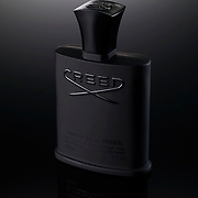 Bottle of Creed aftershave on black glossy background Ray Massey is an established, award winning, UK professional  photographer, shooting creative advertising and editorial images from his stunning studio in a converted church in Camden Town, London NW1. Ray Massey specialises in drinks and liquids, still life and hands, product, gymnastics, special effects (sfx) and location photography. He is particularly known for dynamic high speed action shots of pours, bubbles, splashes and explosions in beers, champagnes, sodas, cocktails and beverages of all descriptions, as well as perfumes, paint, ink, water – even ice! Ray Massey works throughout the world with advertising agencies, designers, design groups, PR companies and directly with clients. He regularly manages the entire creative process, including post-production composition, manipulation and retouching, working with his team of retouchers to produce final images ready for publication.