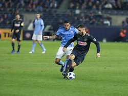 October 31, 2018 - New York, New York, United States - Ronald Matarrita (22) of NYCFC & Keegan Rosenberry (12) of Philadelphia Union fight for ball during knockout round game at Yankees stadium NYCFC won 3 - 1 (Credit Image: © Lev Radin/Pacific Press via ZUMA Wire)