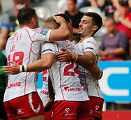 Kieren Moss (R) of Hull Kingston Rovers celebrates scoring his 2nd try of the game with team mate Chris Atkins (C)  and Tommy Lee (L) against Hull FC  during the Betfred Super League match at the Dacia Magic Weekend, St. James's Park, Newcastle<br /> Picture by Stephen Gaunt/Focus Images Ltd +447904 833202<br /> 20/05/2018