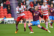 Doncaster Rovers player Rodney Kongolo (7) and Scunthorpe United midfielder Neal Bishop (12)  during the EFL Sky Bet League 1 match between Doncaster Rovers and Scunthorpe United at the Keepmoat Stadium, Doncaster, England on 17 September 2017. Photo by Ian Lyall.