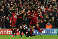 Football - 2019 / 2020 UEFA Champions League - Round of Sixteen, Second Leg: Liverpool (0) vs. Atletico Madrid (1)<br /> <br /> Liverpool's Mohamed Salah battles with Renan Lodi of Atletico Madrid, at Anfield.<br /> <br /> <br /> COLORSPORT/TERRY DONNELLY