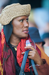 LONDON, ENGLAND - Wednesday, June 24, 2009: Actress and singer Grace Jones, with a glass of red wine, watches a Ladies' Singles 2nd Round match on day three of the Wimbledon Lawn Tennis Championships at the All England Lawn Tennis and Croquet Club. (Pic by David Rawcliffe/Propaganda)
