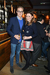 ALEX COLERIDGE and AMBER ATHERTON at the launch of Korean restaurant Jinjuu with chef Judy Joo at 15 Kingley Street, London on 22nd January 2015.