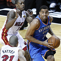 17 June 2012: Oklahoma City Thunder shooting guard Thabo Sefolosha (2) goes toe the basket past Miami Heat point guard Mario Chalmers (15) during the Miami Heat 91-85 victory over the Oklahoma City Thunder, in Game 3 of the 2012 NBA Finals, at the AmericanAirlinesArena, Miami, Florida, USA.